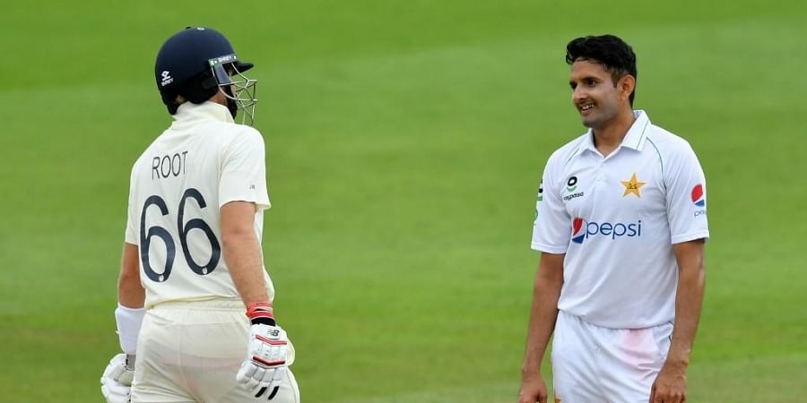 Pakistan's Mohammad Abbas (R) shares a moment with England's Joe Root (L) during play on the fourth day of the first Test cricket match. (Photo | AFP)