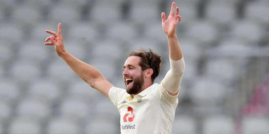 England's Chris Woakes celebrates the wicket of Pakistan captain Azhar Ali during the 3rd day of the first Test match at Old Trafford in Manchester