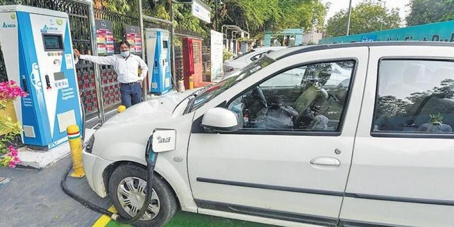 Vehicles being charged at India's first EV charging plaza in New Delhi