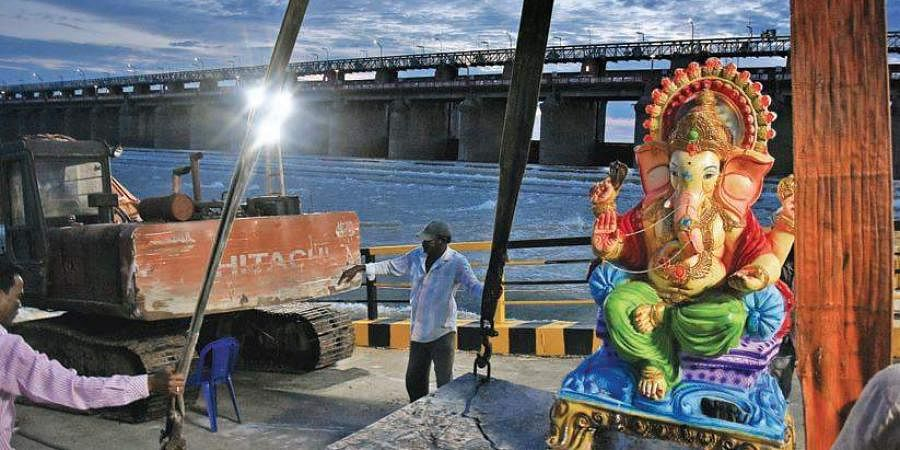 An idol of Lord Ganesha before immersion at the downstream of the Prakasam Barrage in the city on Sunday.