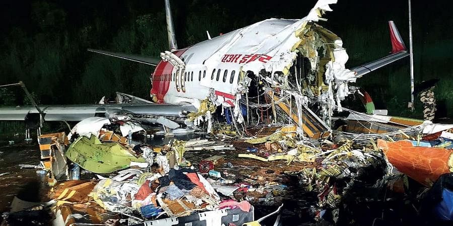The mangled wreckage of the Air India Express plane from Dubai that skidded off the runway at the Kozhikode airport