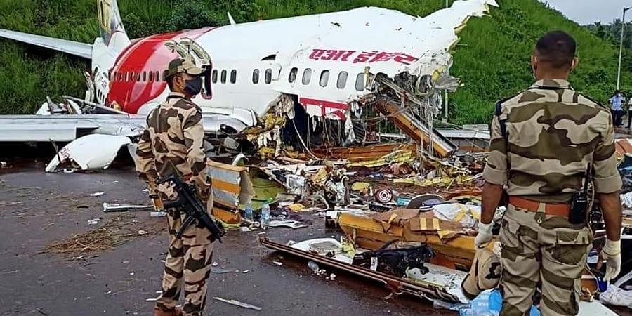 Army personnel stand guard at the site of the wreckage of Air India Express flight at Kozhikode International Airport in Karipur. (Photo  ANI)