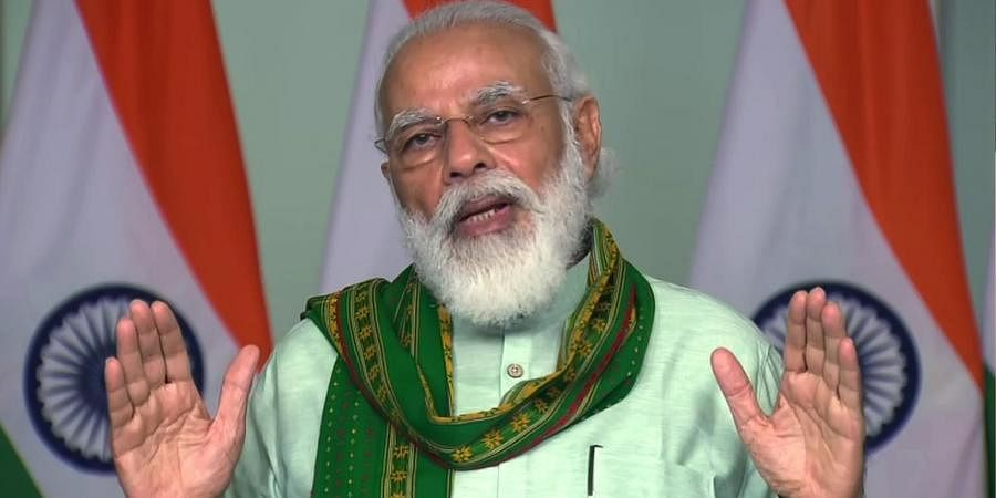 Prime Minister Narendra Modi speaks during a launches financing facility under Agriculture Infrastructure Fund and releases benefits under the PM-KISAN scheme, in New Delhi on Sunday. (Photo | ANI)