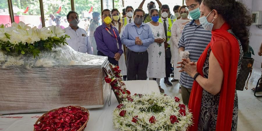 Wife Sushma Sathe and younger son Dhananjay Sathe pay their respects to the mortal remains of Captain Deepak Sathe during his funeral ceremony. (Photo  PTI)