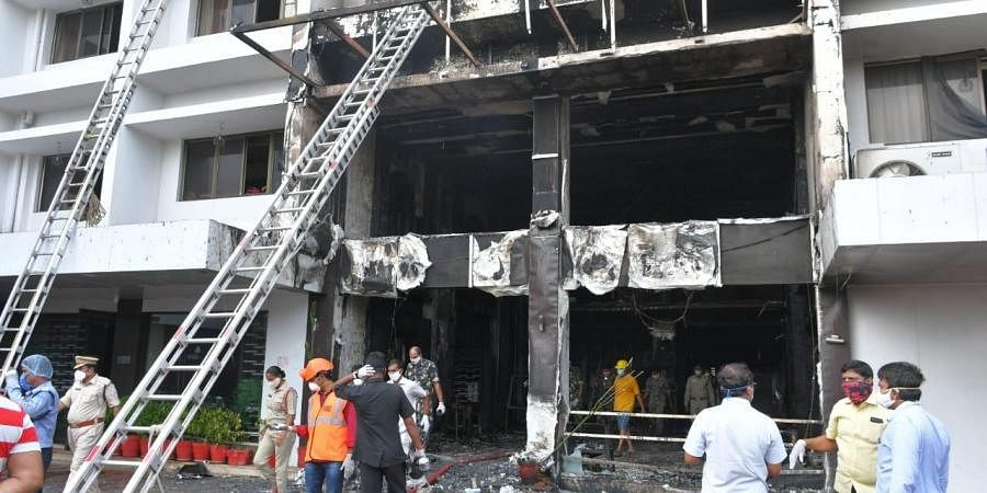 Fire broke out at Swarna Palace where a private hospital took it for treating covid patients in Vijayawada on Sunday.