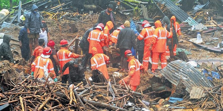 Fire and Rescue Services personnel recover bodies from the landslide spot at Pettimudi in Rajamala in Idukki.