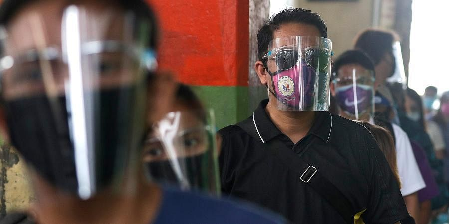 People wearing face mask and face shields to help curb the spread of COVID-19 in Philippines.