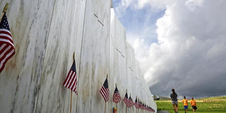 Visitors to the Flight 93 National Memorial pause at the Wall of Names honoring 40 passengers and crew members of United Flight 93 killed when the jet crashed at the site. (File Photo | AP)