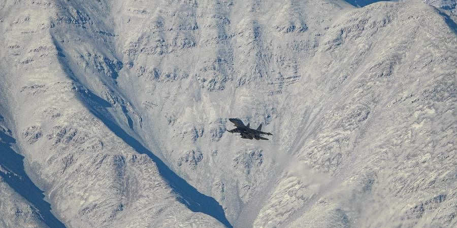 An IAF aircraft flies in the Ladakh region amid the India-China stand off, in Leh