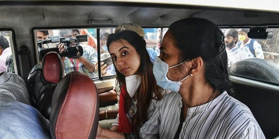 Police personnel escort actor Sanjjanaa Galrani to a hospital for medical checkup after she was arrested in the drugs case in Bengaluru
