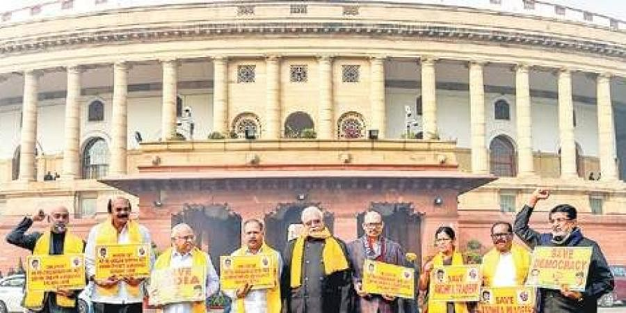 TDP members stage a protest seeking implementation of the AP Reorganisation Act during the winter session of Parliament in New Delhi. (File Photo | PTI)