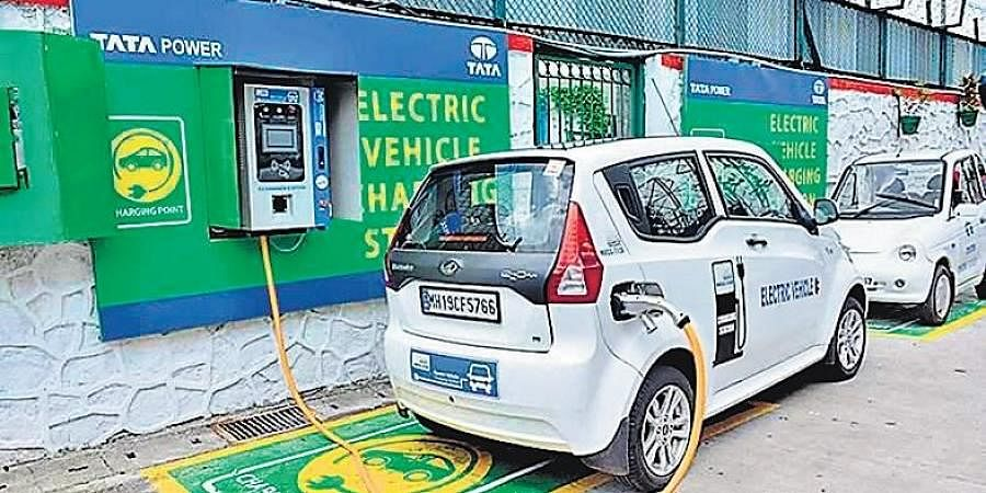 An electric vehicle getting charged at a charging station in Delhi (Photo | EPS)