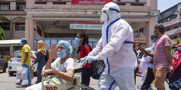 An elderly woman being discharged from a hospital in Indore. (File Photo   PTI)