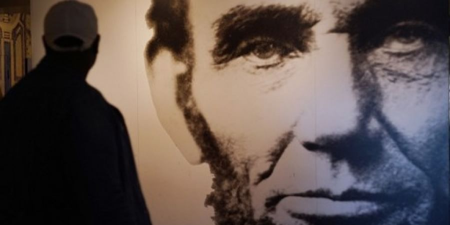 A visitor to an exhibit at the Lincoln Memorial walks past an image of Abraham Lincoln on April 1, 2015 in Washington, DC.