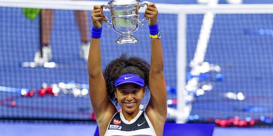 Naomi Osaka, of Japan, holds up the championship trophy after defeating Victoria Azarenka, of Belarus, in the women's singles final of the US Open tennis championships. (Photo | AP)