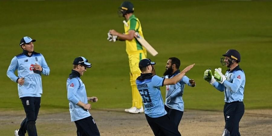 England's wicket keeper Jos Buttler (R) celebrates with bowler England's Adil Rashid. (Photo | AFP)
