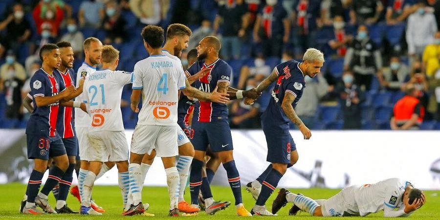 PSG and Marseille players clash near the end of the French League One soccer match between Paris Saint-Germain and Marseille at the Parc des Princes in Paris. (Photo   AP)