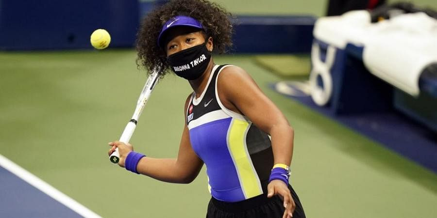 Naomi Osakawears a mask in honor of Breonna Taylor, during the first round of the US Open.