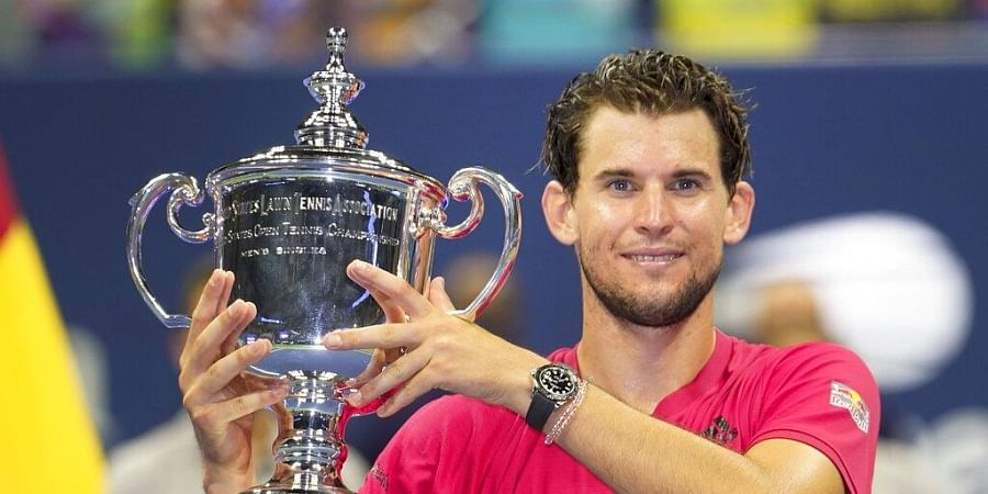 Dominic Thiem, of Austria, holds up the championship trophy after defeating Alexander Zverev, of Germany, in the men's singles final of the US Open tennis championships. (Photo | AP)