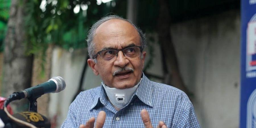 Activist-lawyer Prashant Bhushan addresses a press conference in New Delhi on Monday.