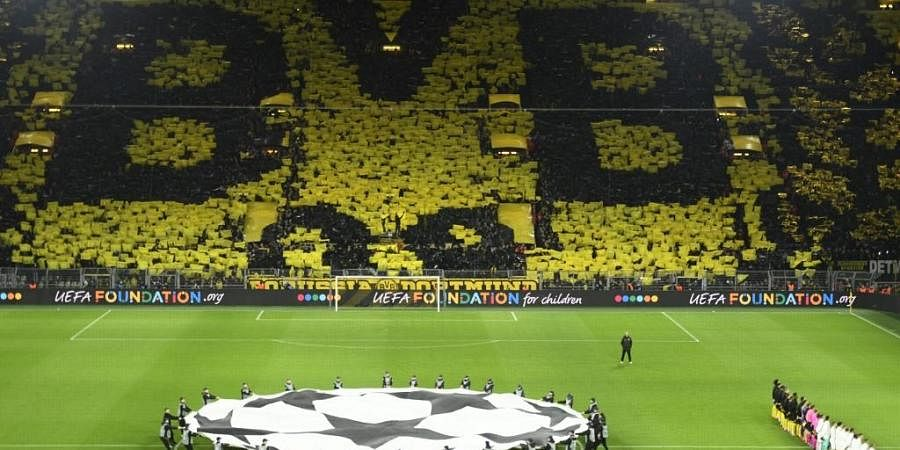 Dortmund fans display their team's logo. (Photo | AFP)