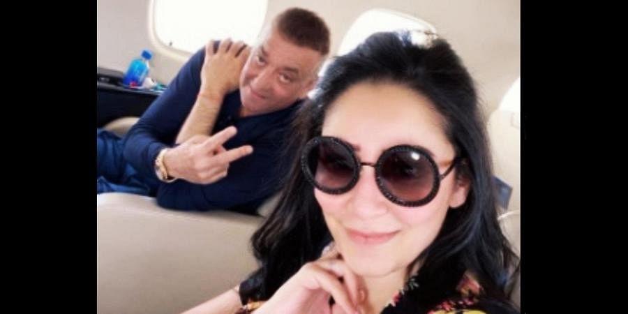 Sanjay Dutt (L) and wife Maanayata on their flight to Dubai