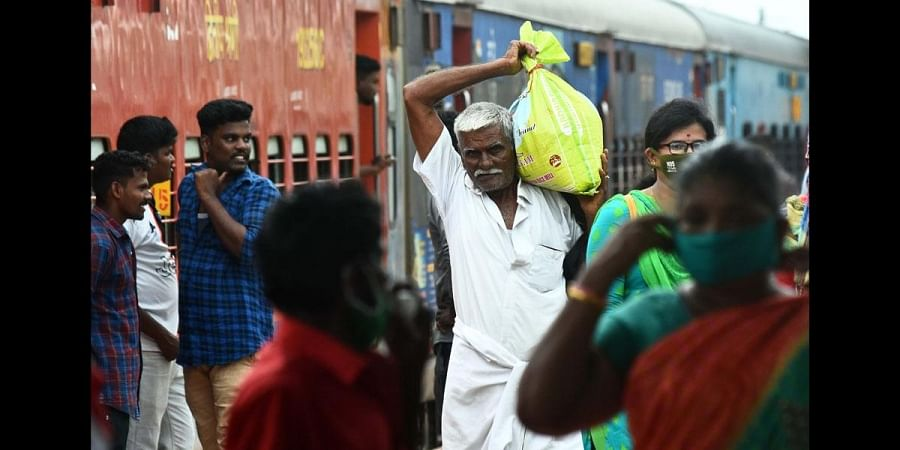 Unmindful of restrictions for visitors at stations during pandemic, many elderly people travelling with heavy luggage in special trains at Tambaram Railway Station
