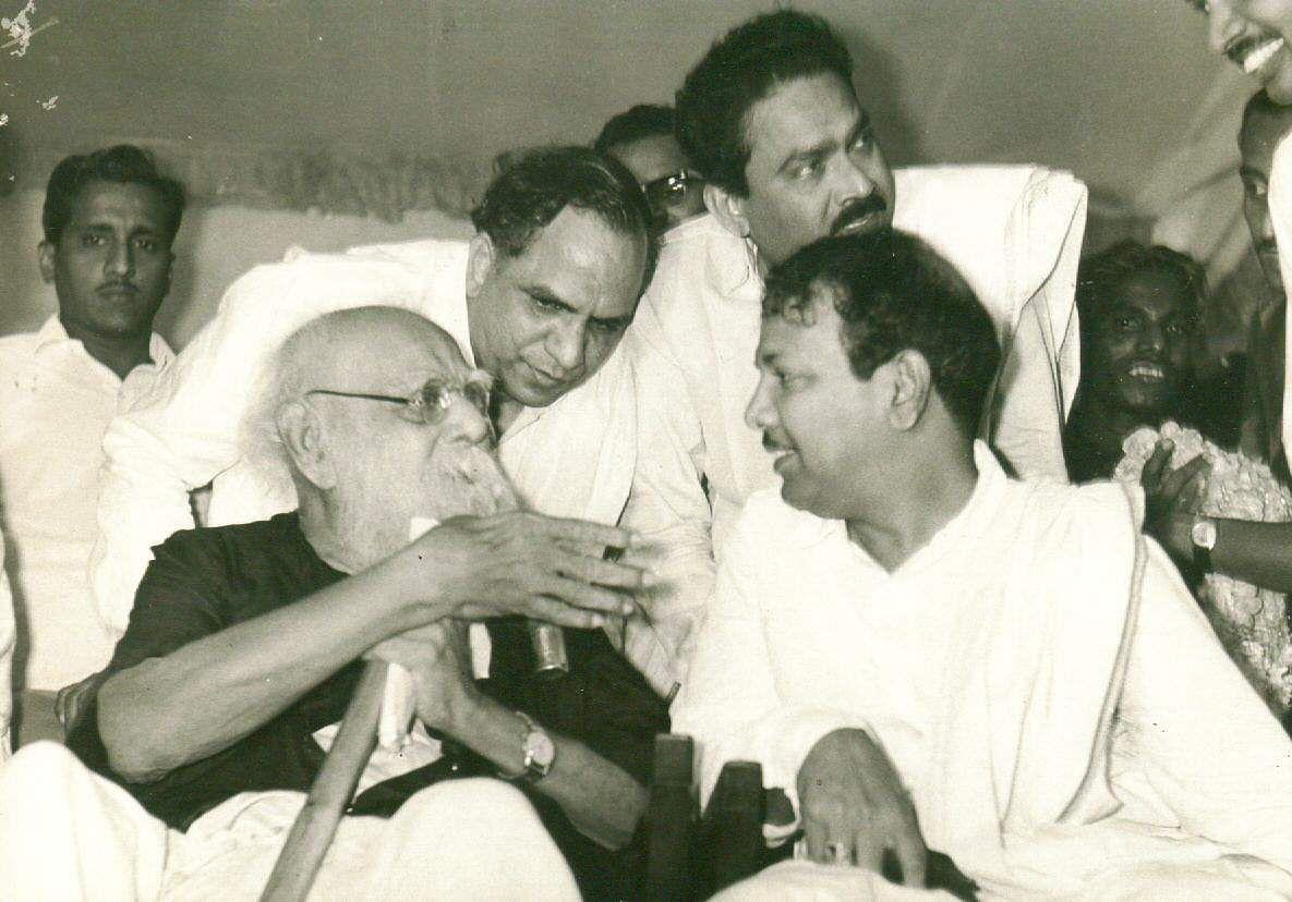 Former Tamil Nadu CM Karunanidhi listens carefully to Periyar.
