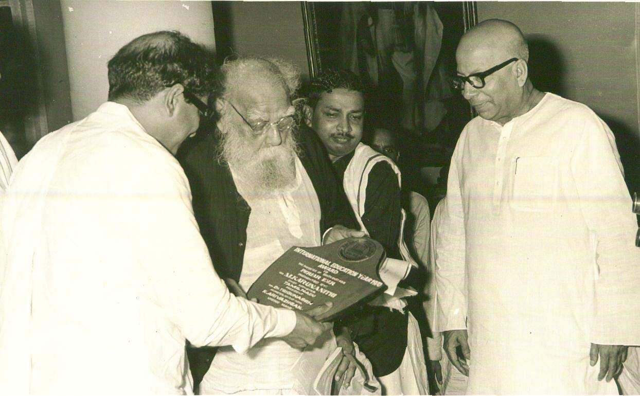 The International education year 1970 was celebrated at 'Rajaji Hall' with the release of 'Kalaignar Kavimanimalai' and the international education awards to 47 distinguished men in various fields picture shows Former Tamil Nadu CM Karunanidhi,  Periyar giving away the awards to distinguished men in various fields.