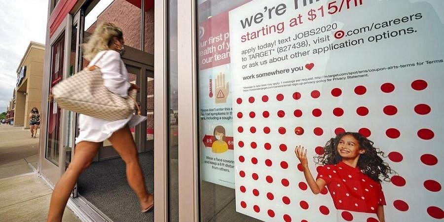 A help wanted sign hangs on the door of a Target store in Pennsilvaniya