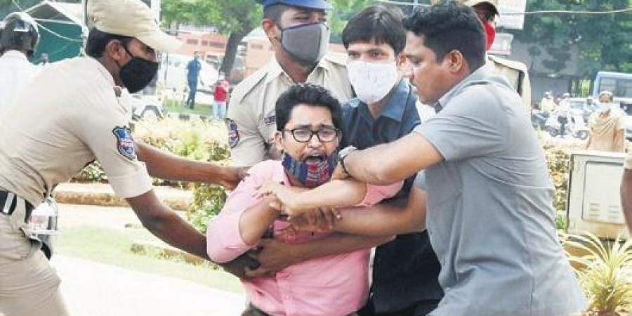 Police detain a government teacher during a protest near the Assembly in Hyderabad on Wednesday.