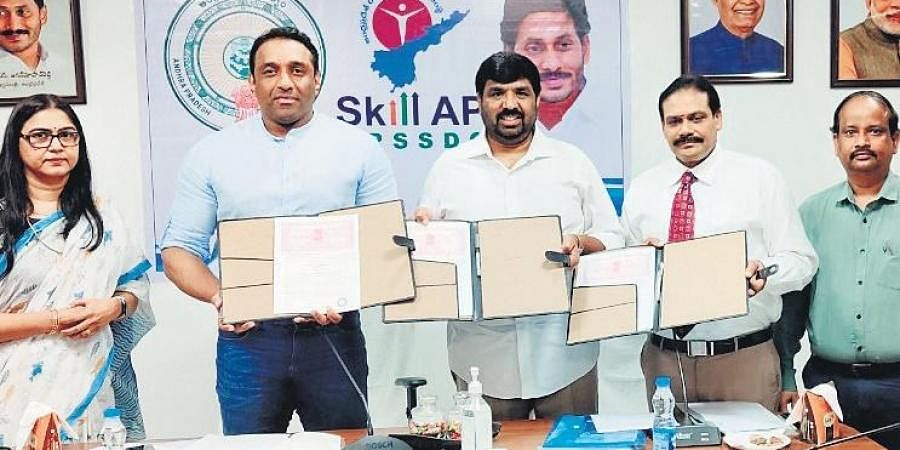 IT and Industries Minister Mekapati Gautam Reddy exchanging MoUs with different companies on skill development at Tadepalli on Wednesday I Express