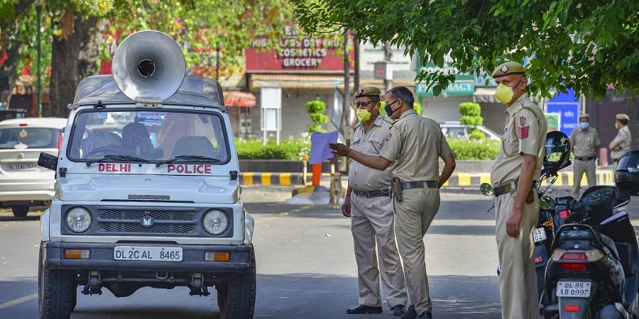 Delhi Police personnel stand guard at Bengali market which has been identified as a containment zone during the nationwide lockdown to curb the spread of coronavirus in New Delhi. (Photo   PTI)