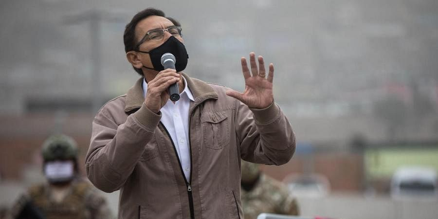 Peru's President Martin Vizcarra talks to doctors and soldiers before the start of a house-to-house coronavirus testing drive near Lima