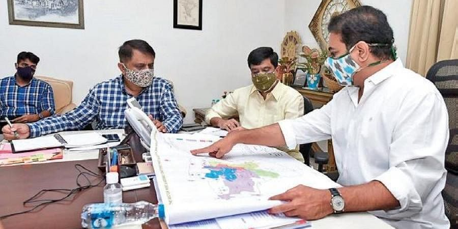 MAUD Minister KT Rama Rao and R&B Minister V Prashanth Reddy review the progress of construction of 2BHKs in the GHMC limits, on Thursday.