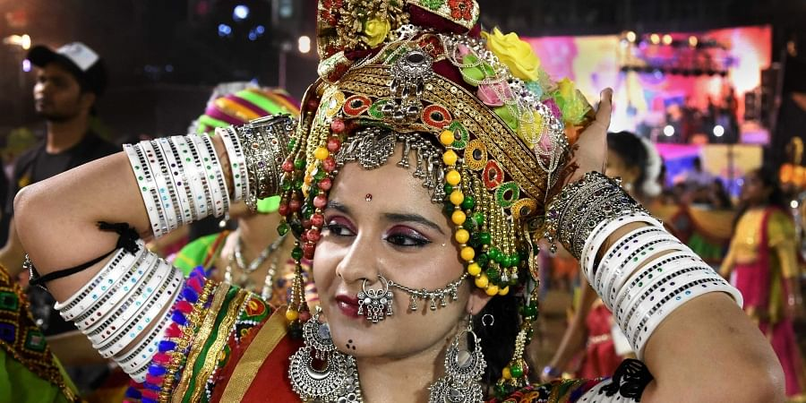 A devotee participates in a Garba dance performance during the Navratri festival celebrations.