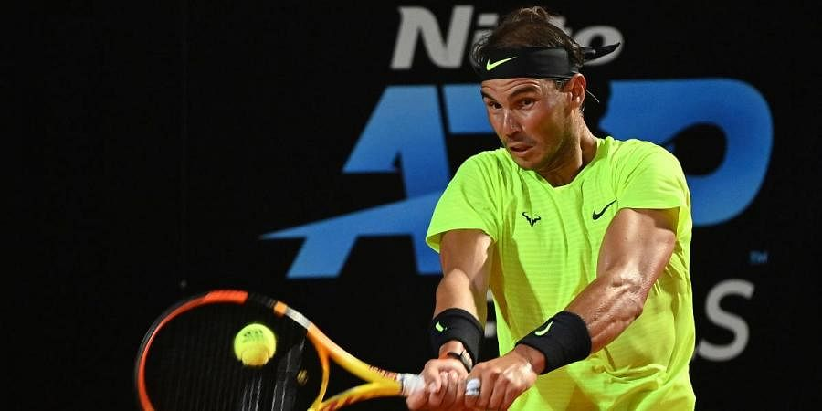 Spain's Rafael Nadal returns the ball to Serbia's Dusan Lajovic during their Italian Open tennis tournament match, in Rome