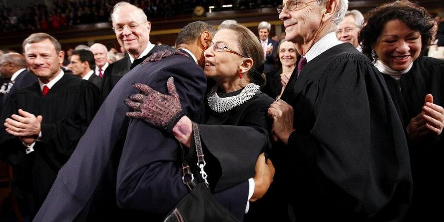 In this Jan. 25, 2011, file photo, President Barack Obama hugs Supreme Court Justice Ruth Bader Ginsburg on Capitol Hill in Washington. (Photo   AP)