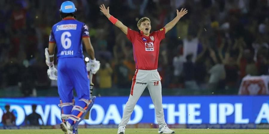 Kings XI Punjab pacer Sam Curran celebrates his hattrick for IPL 2019 as Delhi Capitals' Avesh Khan watches on