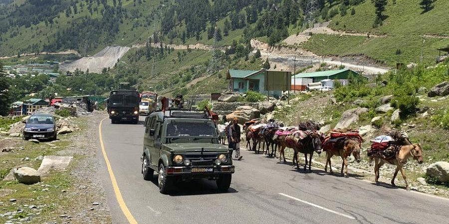 An Indian army convoy moves on the Srinagar-Ladakh highway at Gagangeer, north-east of Srinagar.