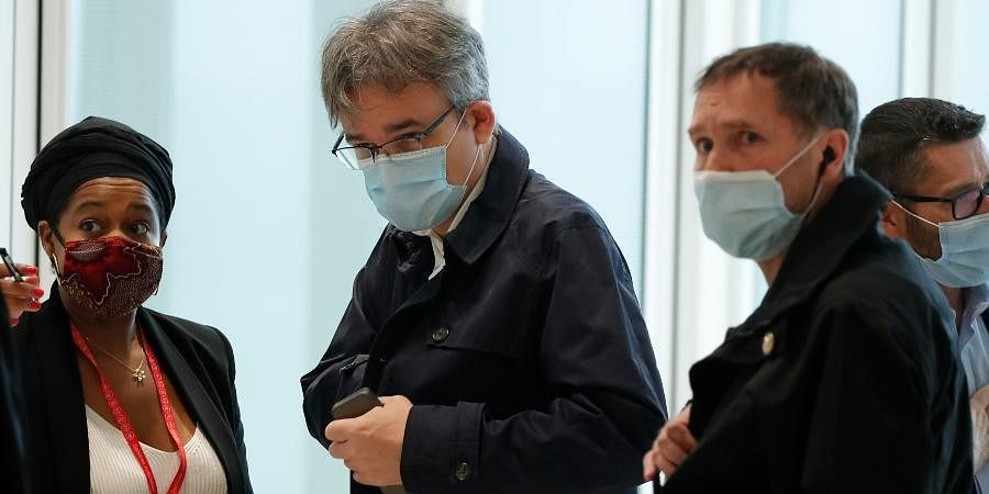 Satirical newspaper Charlie Hebdo's chief editor, Laurent Sourisseau, known as Riss (C)arrives at the courtroom for the opening of the 2015 attacks trial in Paris.