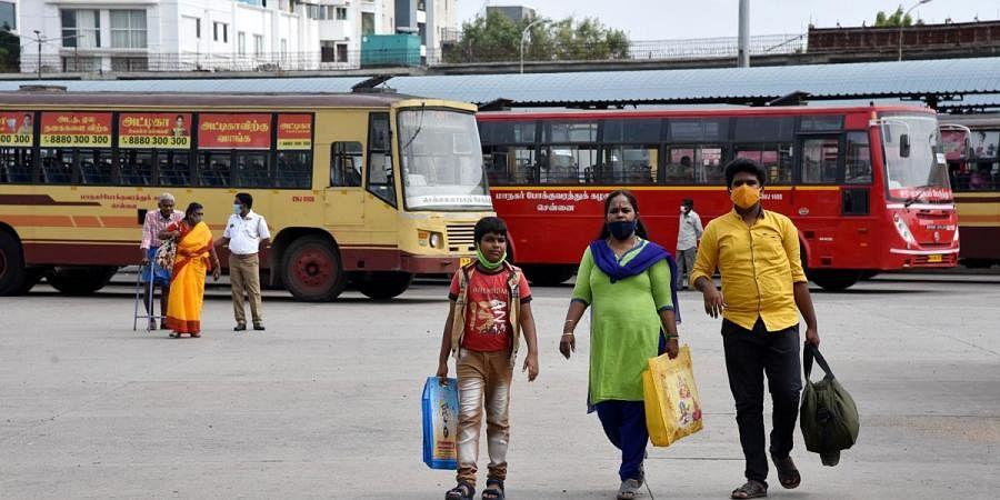 Passengers waiting to board MTC bus at Koyambedu bus stand in Chennai