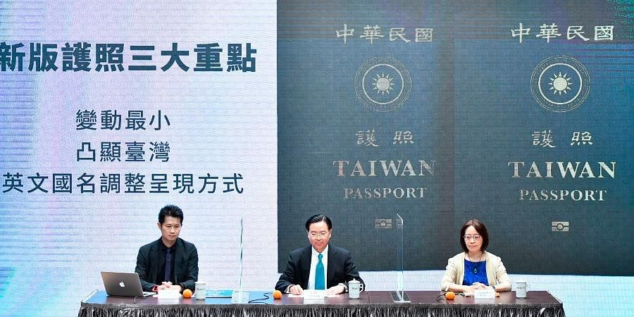 Taiwan's FM Joseph Wu (C), Executive Yuan spokesperson Evian Ting (L) and Director of Consular Affairs Bureau Phoebe Yeh attends a conference to reveal the new Taiwan passport in Taipei.