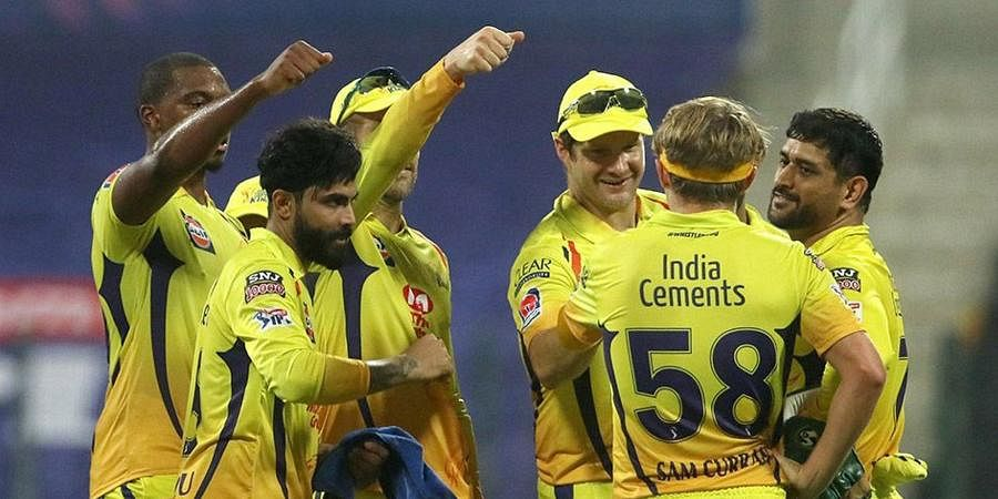 CSK players react after the wicket of Mumbai Indians player Quinton de Kock during the first cricket match of IPL 2020 at Sheikh Zayed Stadium.
