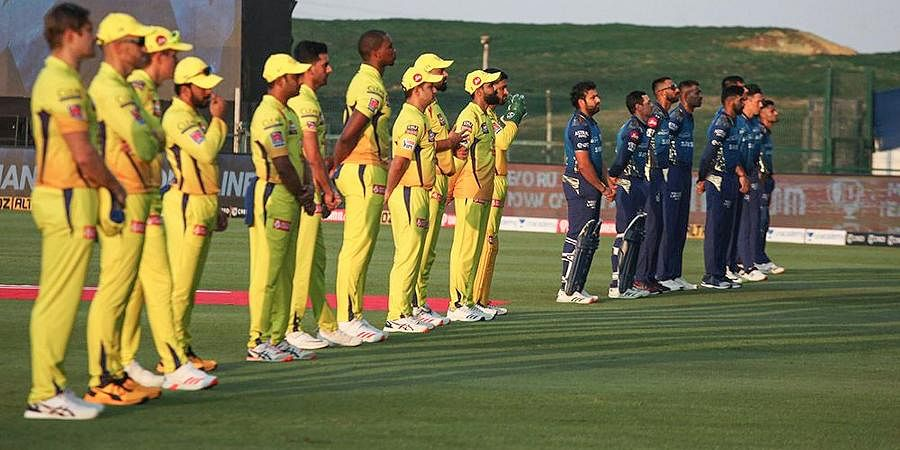 Players of CSK and Mumbai Indians line up before the start of the first cricket match at IPL 2020 at Sheikh Zayed Stadium.