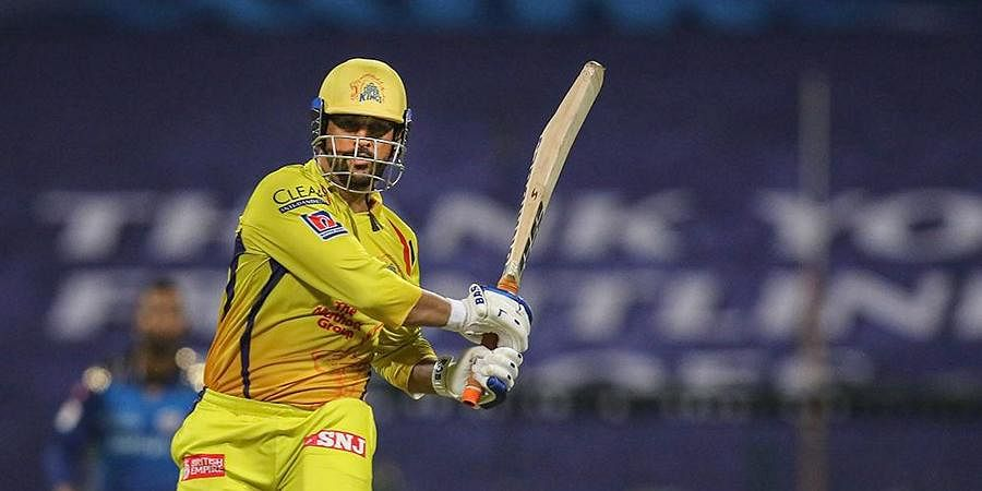 CSK Skipper MS Dhoni plays a shot during the first cricket match of IPL 2020 against Mumbai Indians at Sheikh Zayed Stadium.