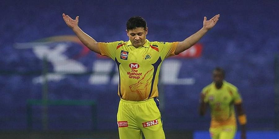 CSK player Piyush Chawla reacts after taking the wicket of Mumbai Indians Skipper Rohit Sharma during the first cricket match of IPL 2020 at Sheikh Zayed Stadium.
