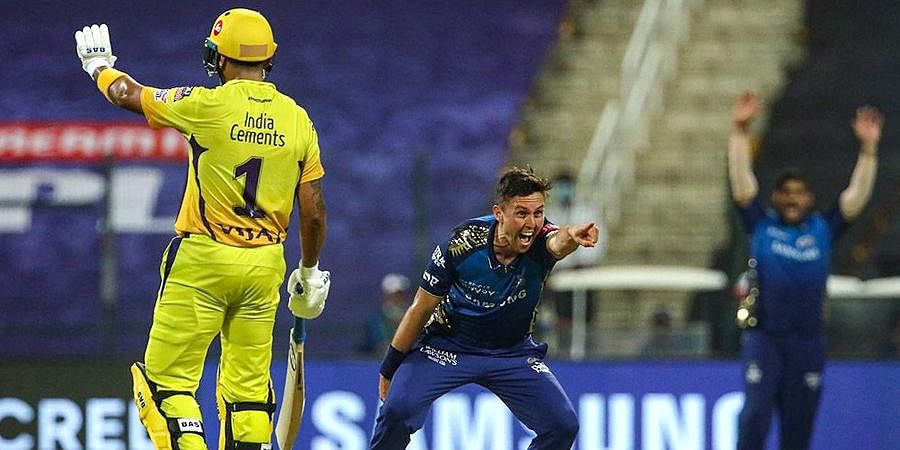 Mumbai Indians player Trent Boult reacts after taking the wicket of CSK player Shane Watson during the first cricket match of IPL 2020 at Sheikh Zayed Stadium.