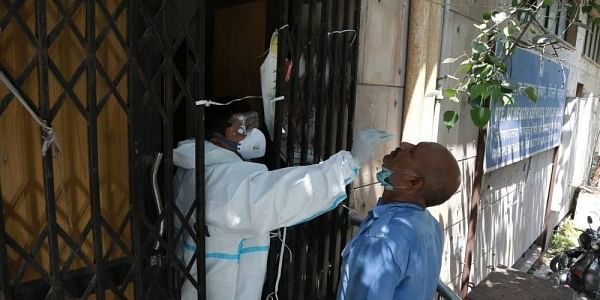 A health worker takes smaples for Covid-19 rapid antigen tests for coronavirus test. (Photo | Shekhar Yadav/EPS)