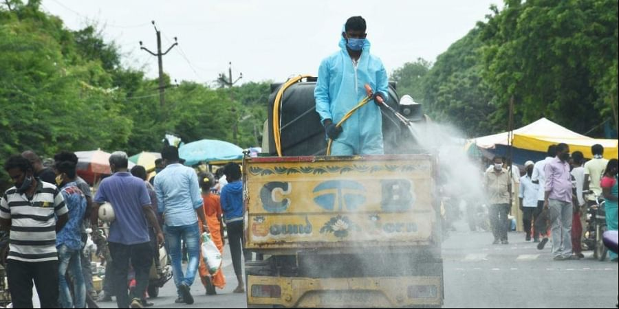 Disinfectants been sprayed at the Pallavaram wholesale weekly market in Chennai which resumed after 5 months